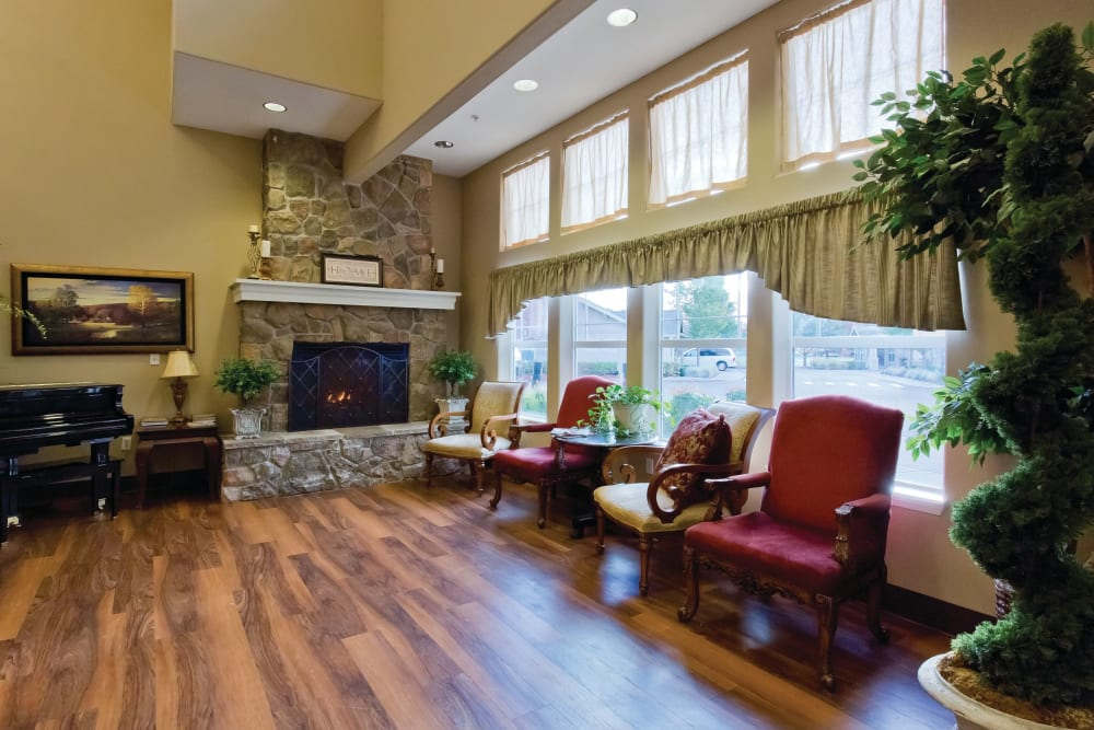 Large foyer with fireplace at Meadowlark Senior Living in Lebanon, Oregon