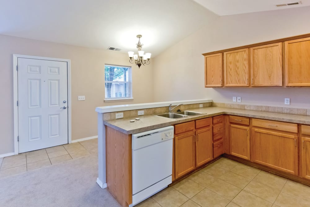 Bright model kitchen at Heron Pointe Senior Living in Monmouth, Oregon