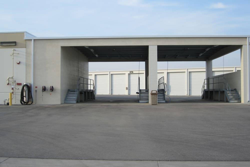 Covered loading areas at Daytona RV & Boat Storage in Perris, California