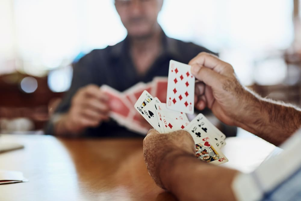 Winning poker hand at Keystone Place at Naples Preserve in Naples, Florida