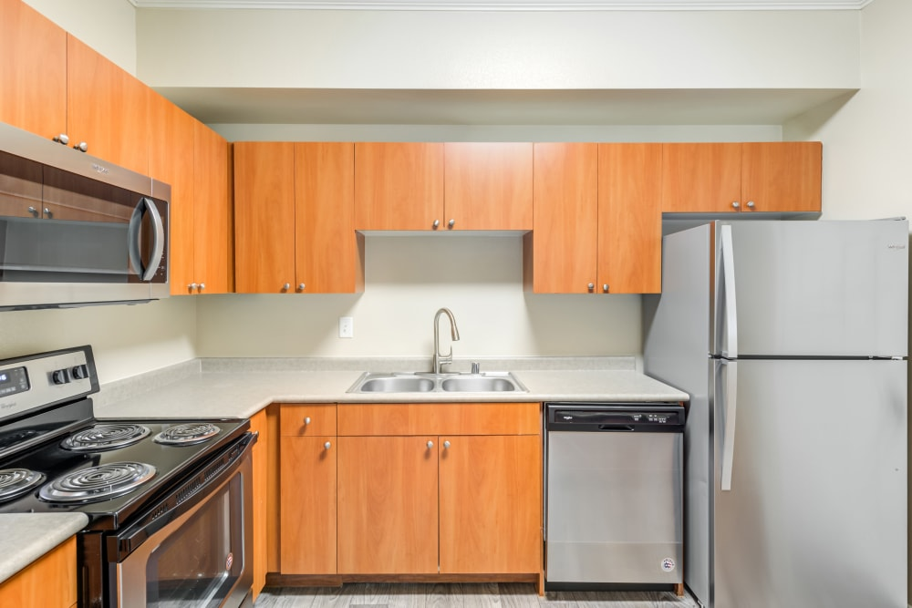 Model kitchen with stainless steen appliances at The Landing at Mansfield in Mansfield, Texas