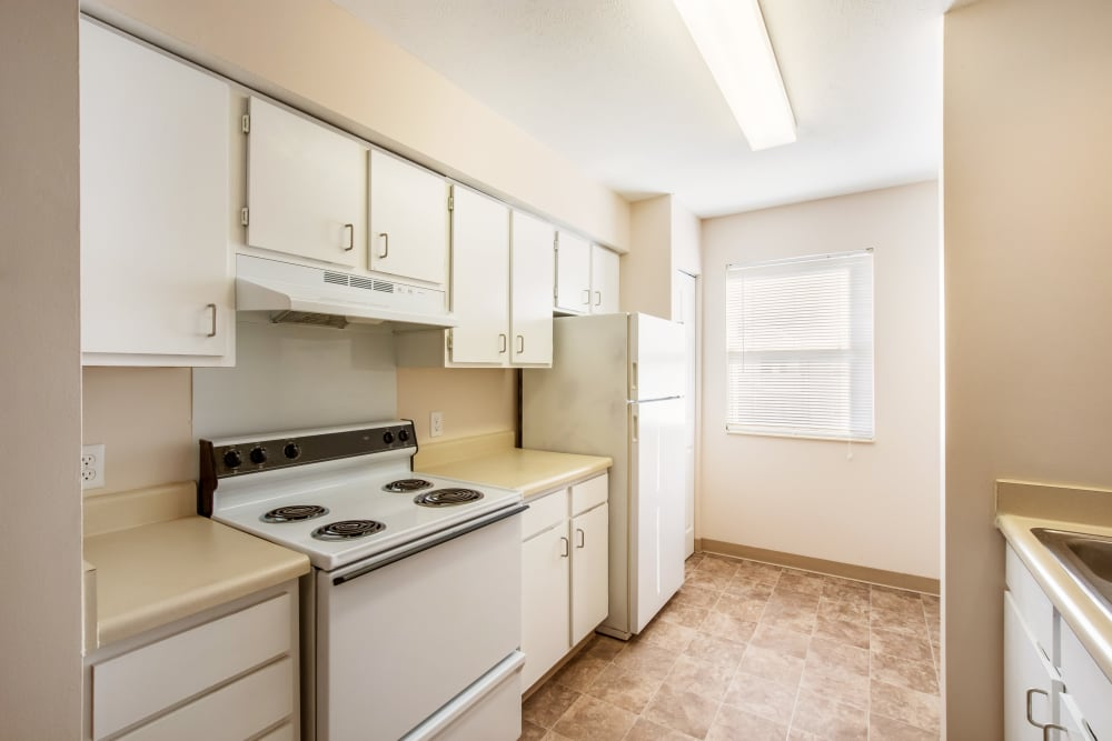 Spacious kitchen at Arbor Crossings Apartments in Muskegon, Michigan