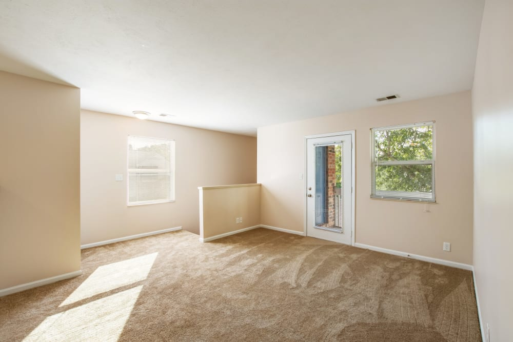 Spacious room with balcony access at Arbor Crossings Apartments in Muskegon, Michigan