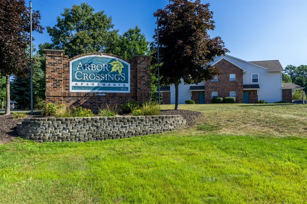 Sign to Arbor Crossings Apartments in Muskegon, Michigan