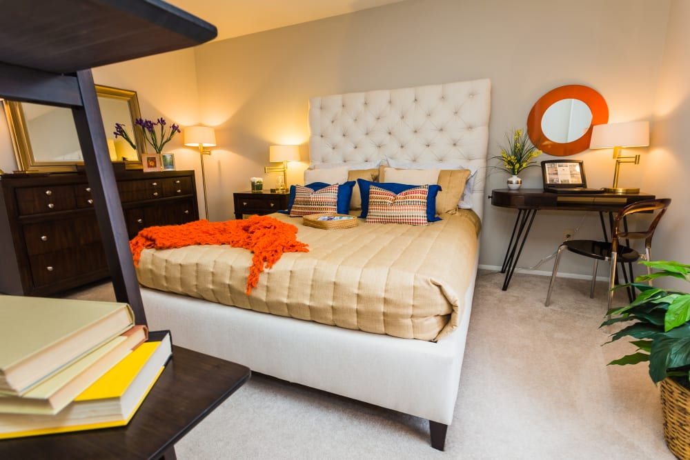 Well decorated, bright bedroom at Cavalier Manor in Eastpointe, Michigan