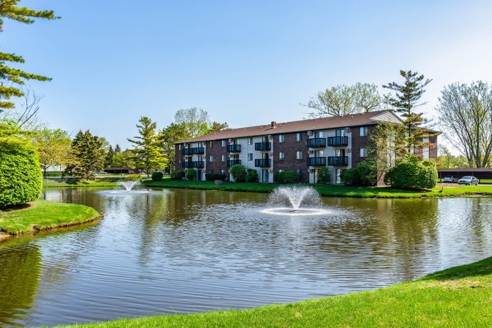 Exterior with beautiful water feature at Oldebrook Apartments in Wyoming, Michigan