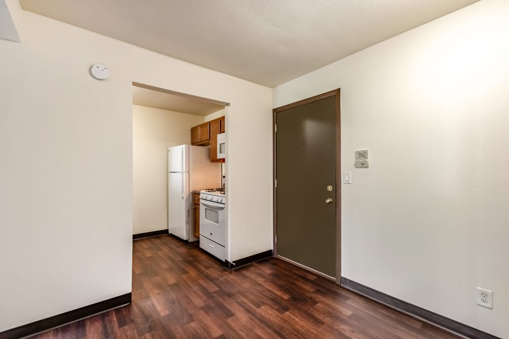 Room with hardwood floors at Oldebrook Apartments in Wyoming, Michigan