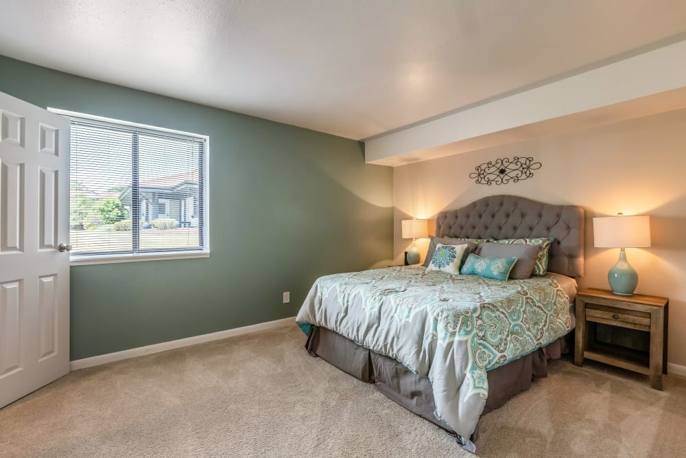 Spacious master bedroom at Okemos Station Apartments in Okemos, Michigan