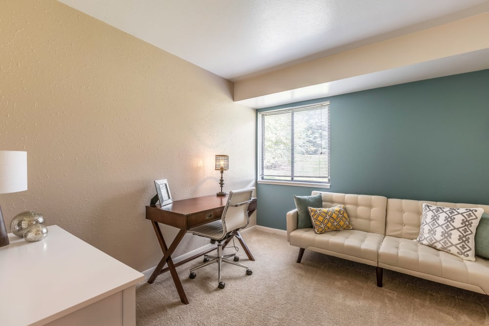 Bright, spacious living room at Okemos Station Apartments in Okemos, Michigan