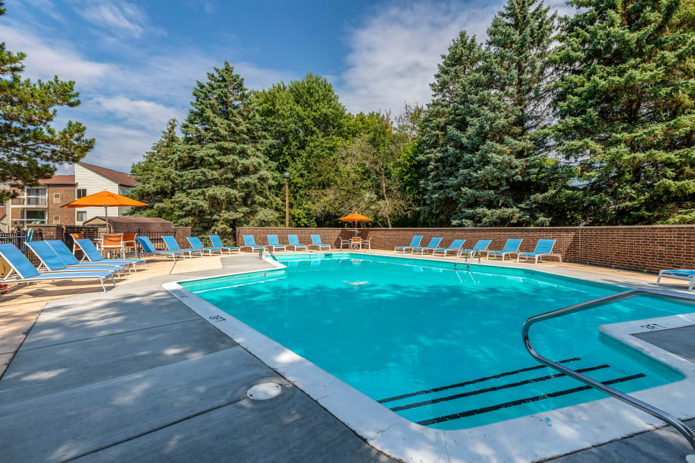 Resort-style swimming pool at Okemos Station Apartments in Okemos, Michigan