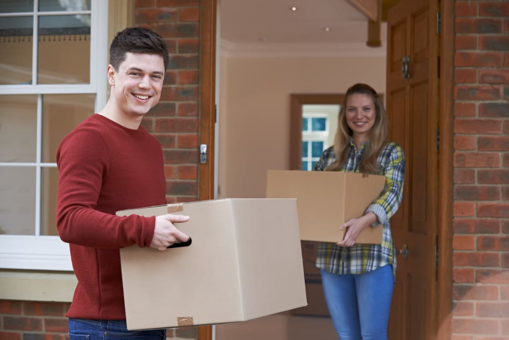 Couple moving boxes from Towne Storage in Henderson, Nevada