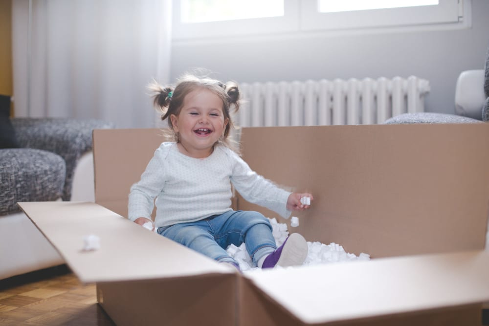 Baby playing in a box at Self Storage of Anderson in Cincinnati, Ohio