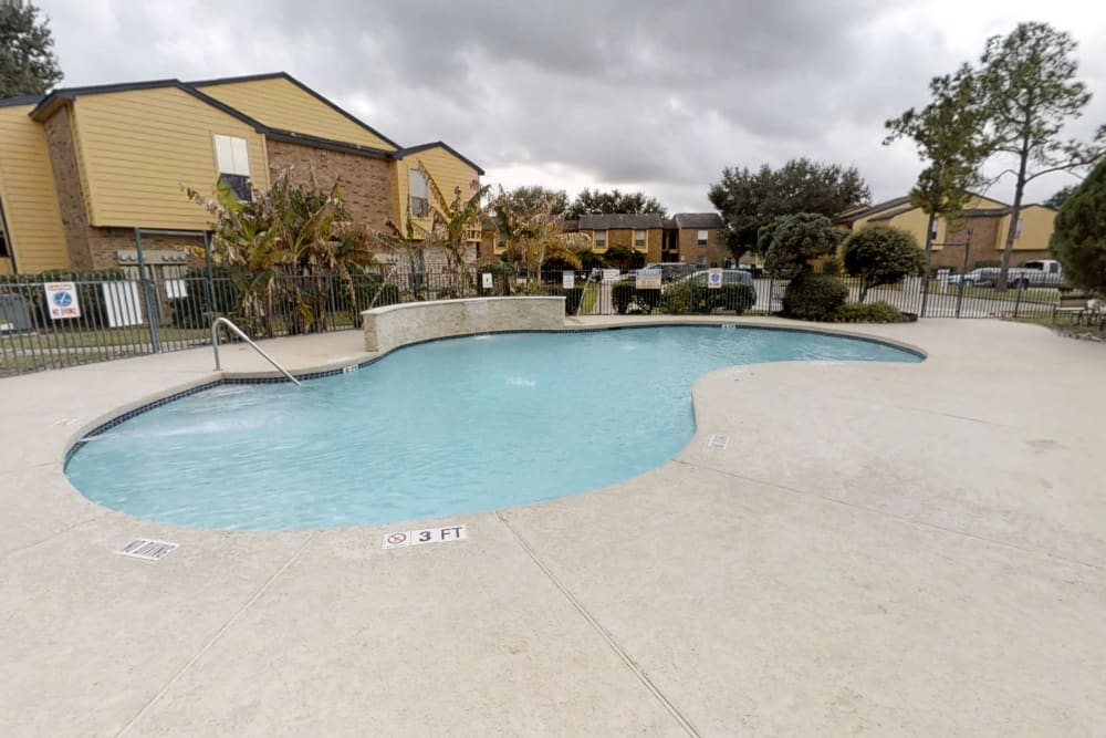 Swimming pool at Meadow Park Apartments in Alvin, Texas