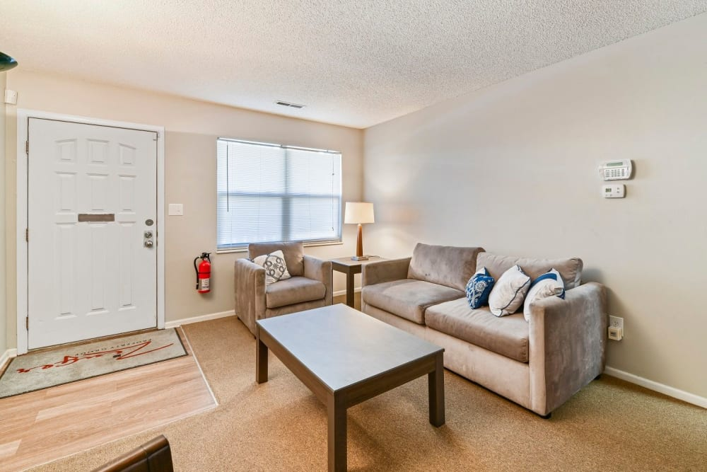 Spacious living room with plush carpeting at Creekbend Apartments in Columbus, Ohio