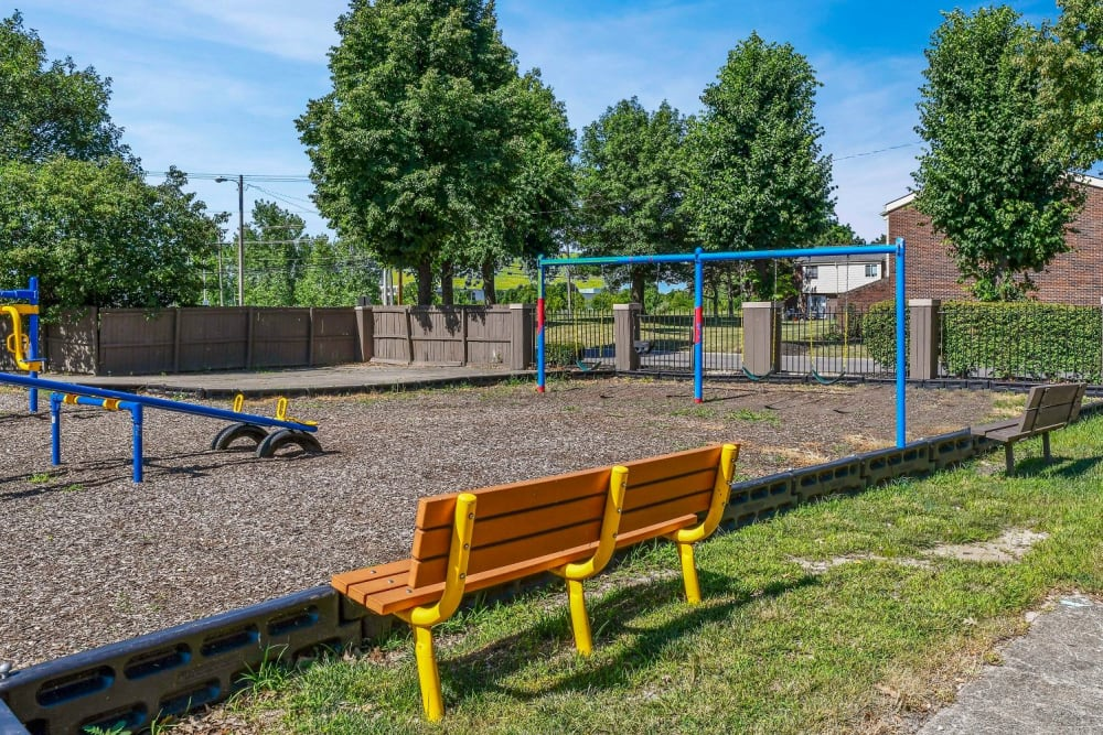 Large children's playground with benches at Hidden Creek Apartment Homes in Columbus, Ohio