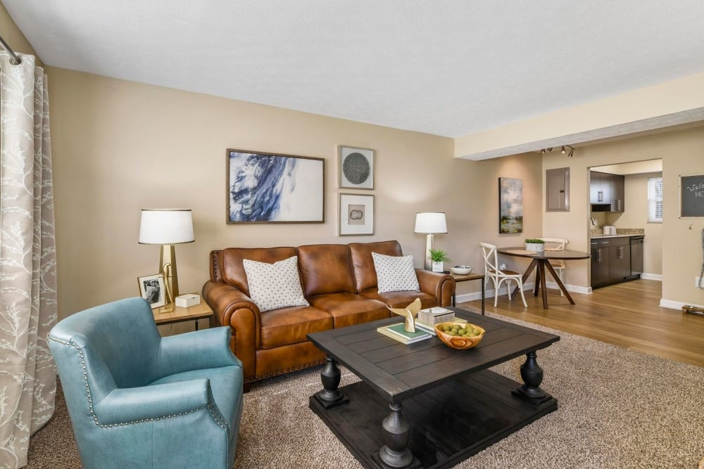 Open-concept floor plan with a living room and dining room at Hidden Creek Apartment Homes in Columbus, Ohio