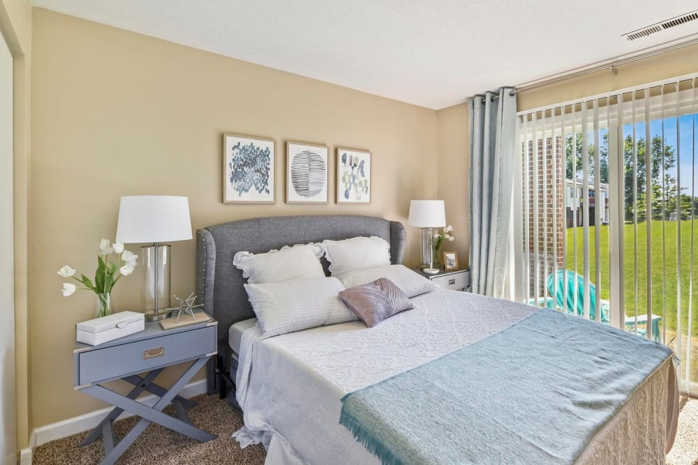 Large bedroom with sliding glass door leading to your personal patio at Hidden Creek Apartment Homes in Columbus, Ohio
