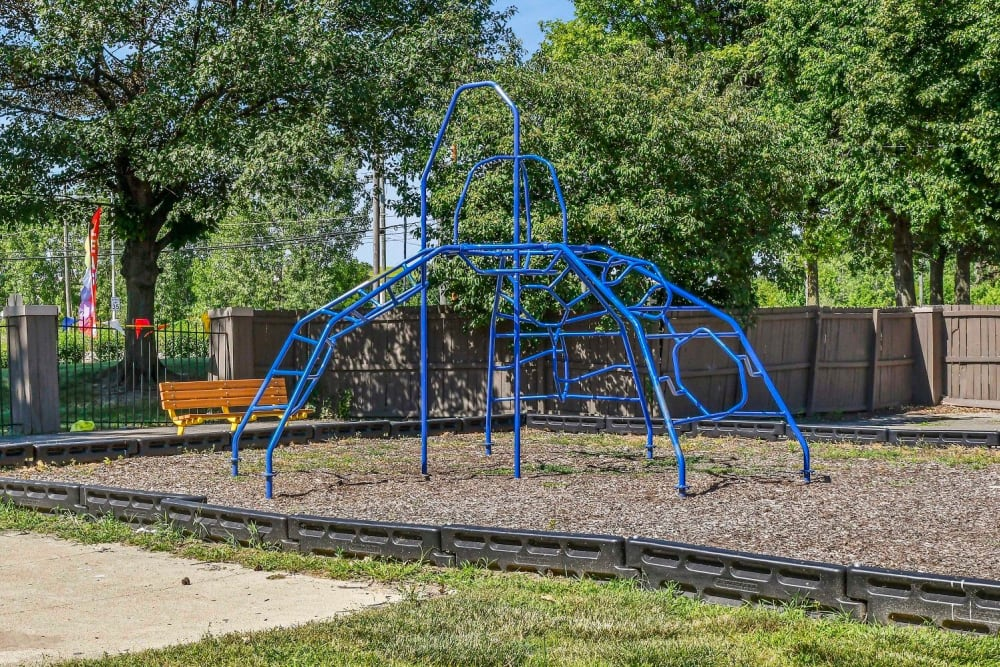 Large children's park with a jungle gym at Hidden Creek Apartment Homes in Columbus, Ohio