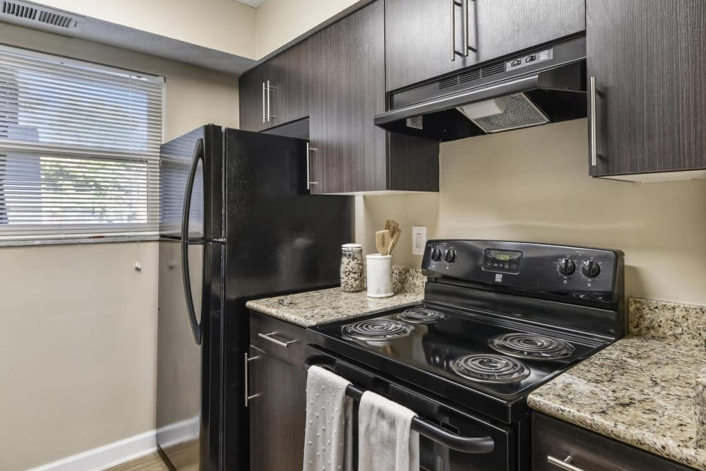 Kitchen with wood-style cabinets at Hidden Creek Apartment Homes in Columbus, Ohio