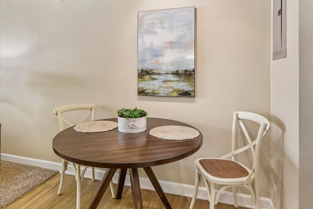 Dining room nook with wood-style flooring at Hidden Creek Apartment Homes in Columbus, Ohio