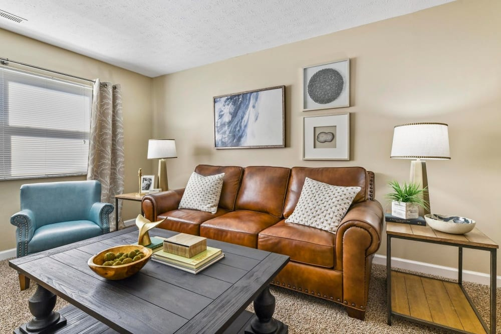 Living room with wood-style flooring at Hidden Creek Apartment Homes in Columbus, Ohio