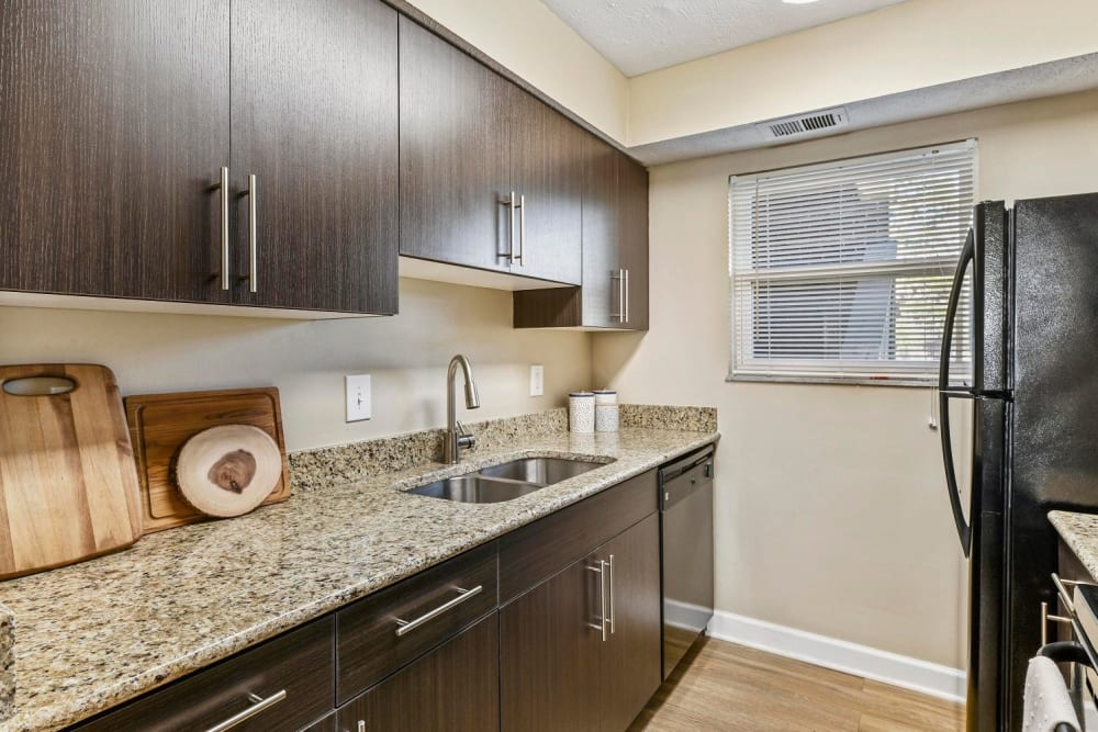 Kitchen with granite counter tops and black appliances at Hidden Creek Apartment Homes in Columbus, Ohio