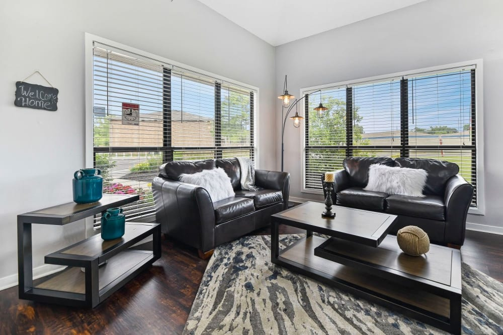 Spacious living room with two large windows at Bolton Estates Apartments in Columbus, Ohio