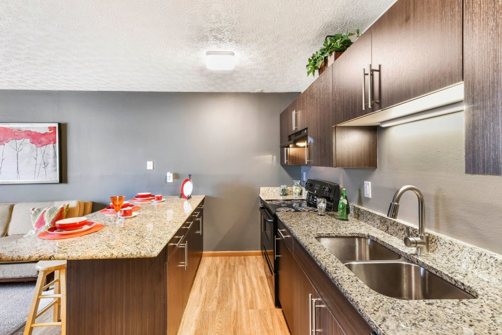 Spacious kitchen with a breakfast bar at Bolton Estates Apartments in Columbus, Ohio
