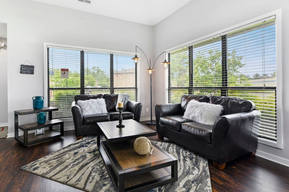 Spacious living room with wood floors at Bolton Estates Apartments in Columbus, Ohio