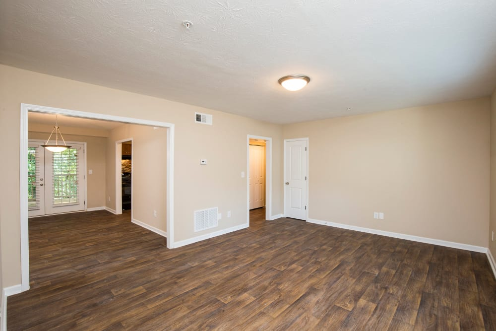 Large living area with hardwood floors at The Crossing at Henderson Mill in Atlanta, Georgia