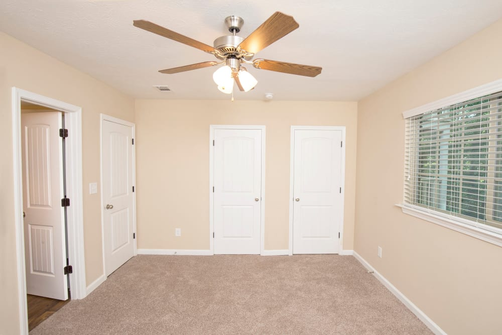 Bedroom with a closet and a ceiling fan at The Crossing at Henderson Mill in Atlanta, Georgia