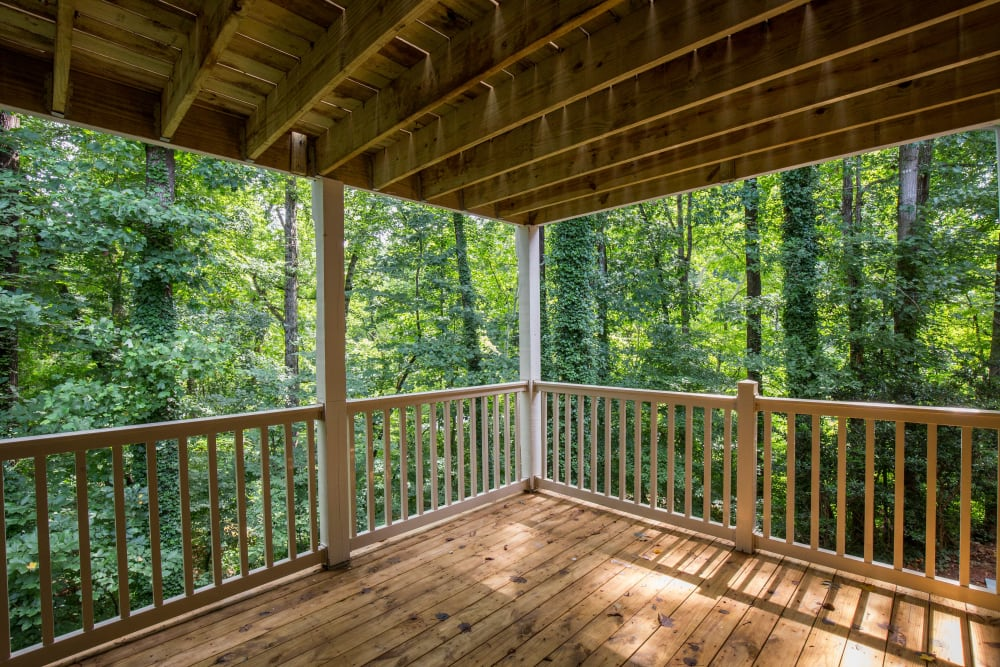Beautiful balcony with forest views at The Crossing at Henderson Mill in Atlanta, Georgia