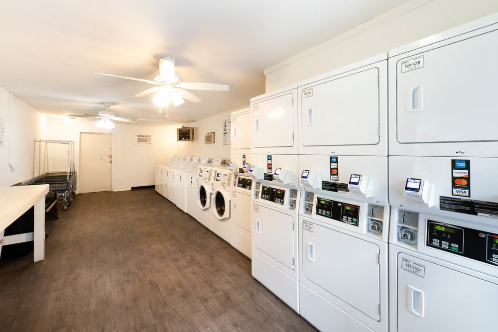 A laundry room with sever washer and dryer units at Riverside North in Chattanooga, Tennessee