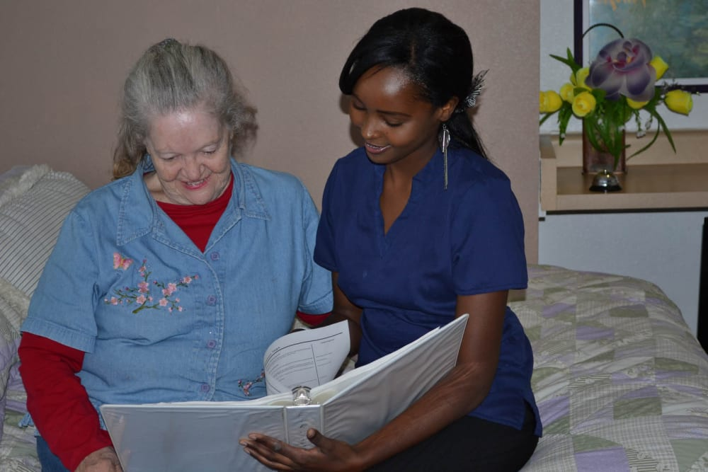 A senior with her caretaker at Copper Heights in Mesa, Arizona