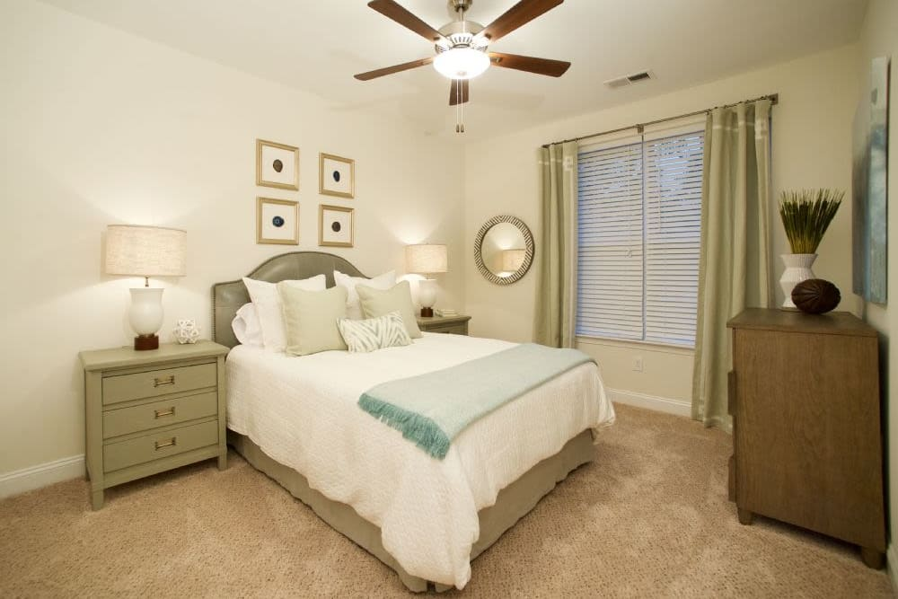 Spacious bedroom with a ceiling fan at Encore North in Greensboro, North Carolina