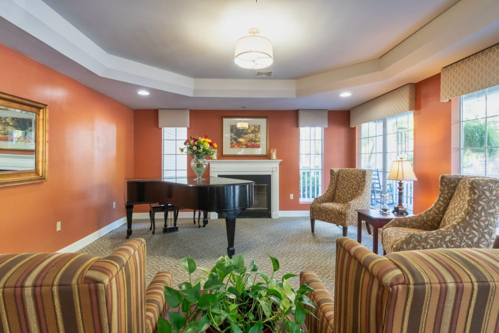 Sitting room with piano at Summer Breeze Senior Living