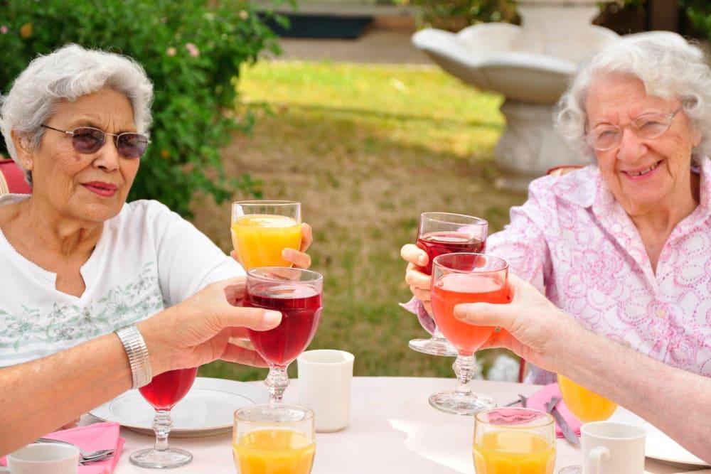 Seniors toasting at Villa Maria Care Center in Tucson, Arizona