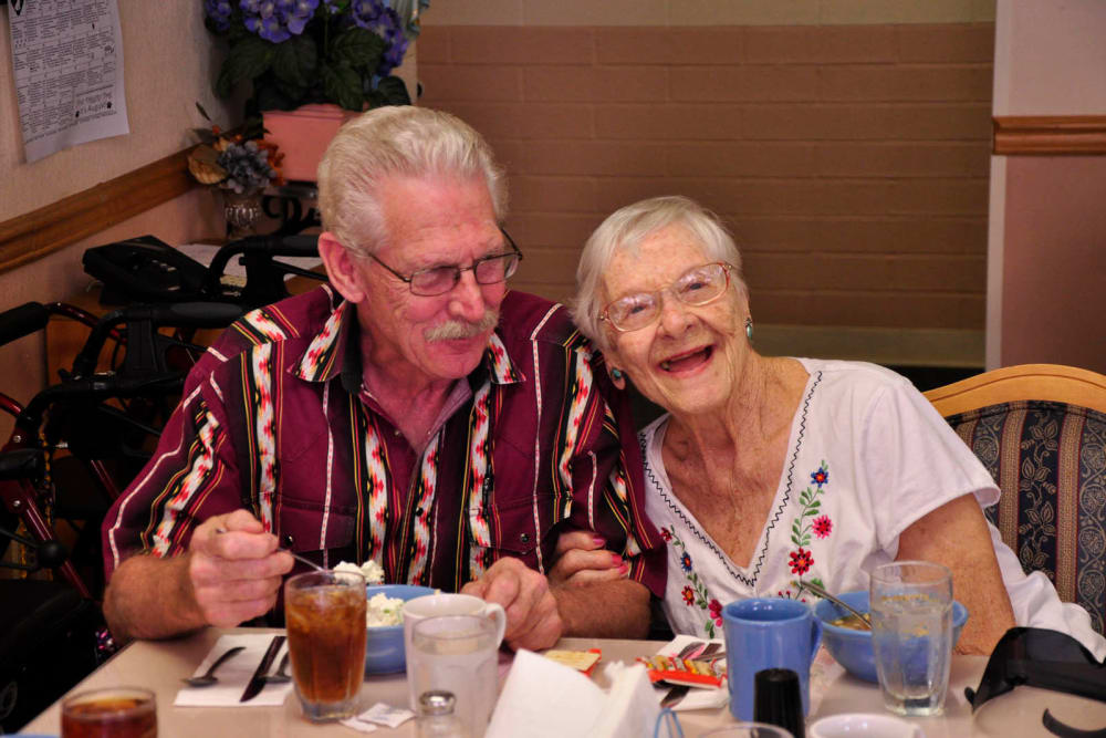 A couple sitting next to each other at Villa Maria Care Center in Tucson, Arizona