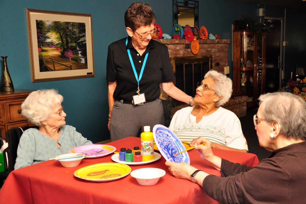 Seniors enjoying arts and crafts at Villa Maria Care Center in Tucson, Arizona