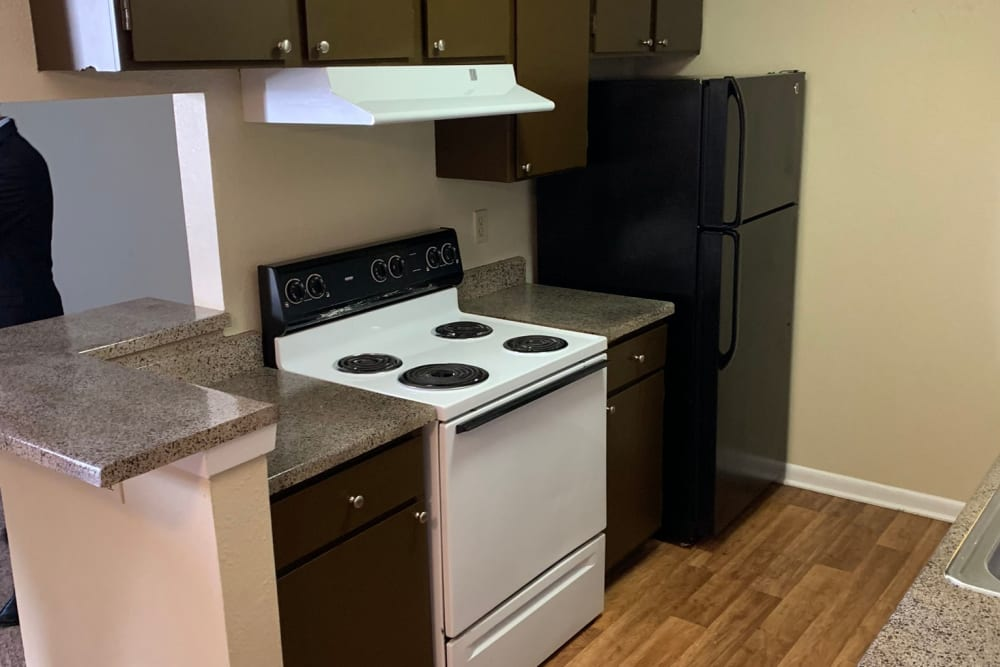 Full kitchens at Carriage House Apartments in Nederland, Texas