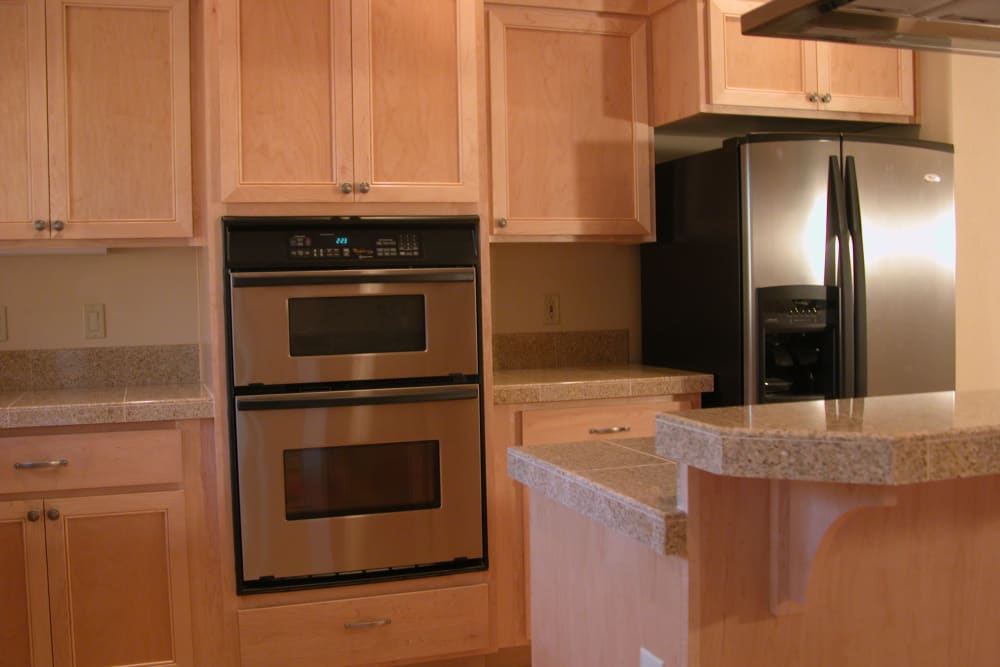 An apartment kitchen with stainless steel appliances at Touchmark at Mount Bachelor Village in Bend, Oregon