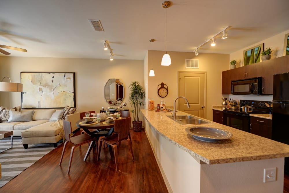 Dining room and kitchen at Terraces at Town Center in Jacksonville, Florida