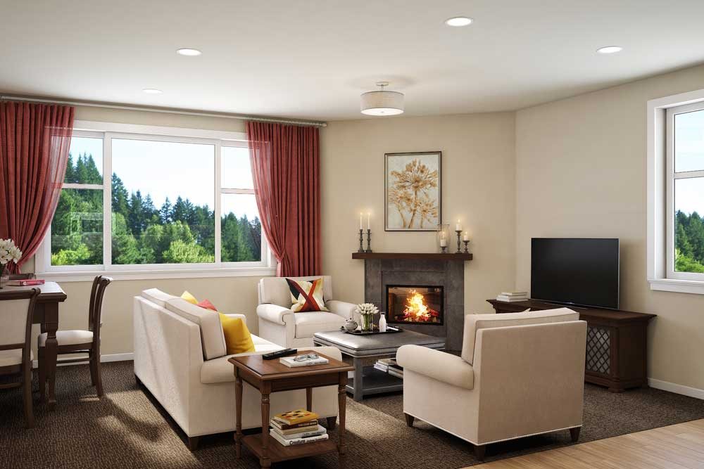 A cozy living room with a fireplace at Touchmark on West Century in Bismarck, North Dakota