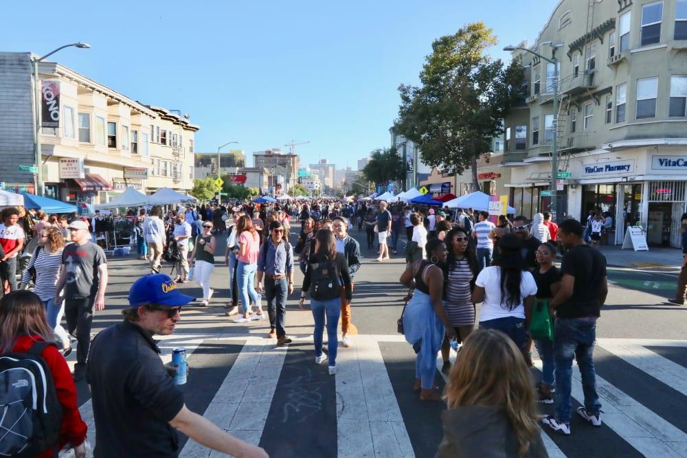 People walking around near Telegraph Arts in Oakland, California