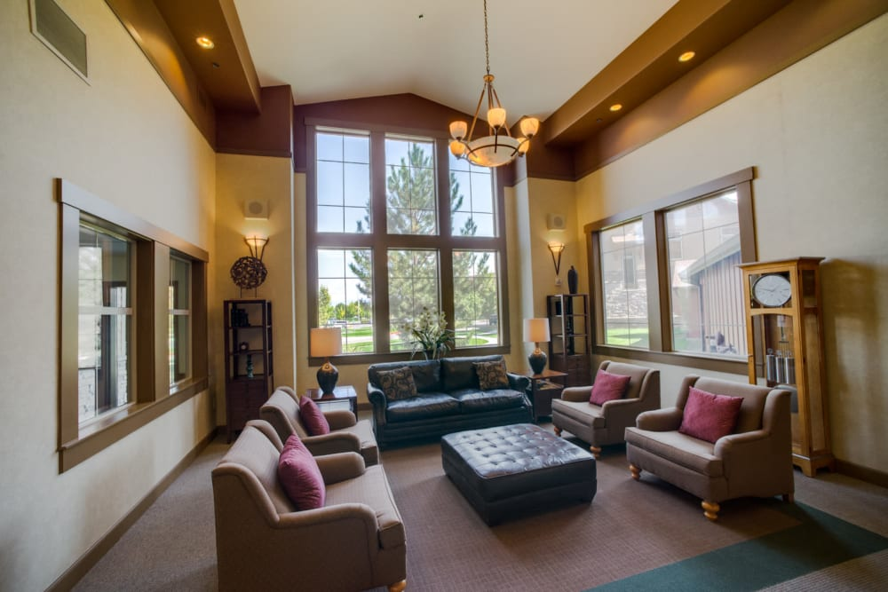 A cozy living room with a fireplace at Touchmark at Meadow Lake Village in Meridian, Idaho