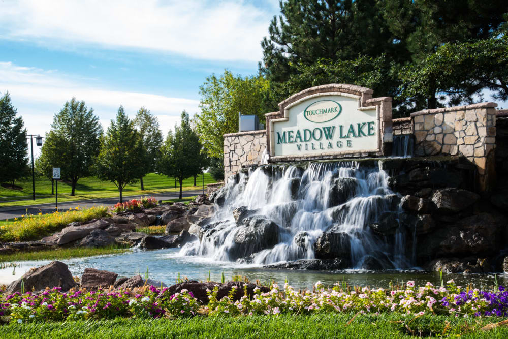 Branding and signage  with a man-made waterfall at Touchmark at Meadow Lake Village in Meridian, Idaho