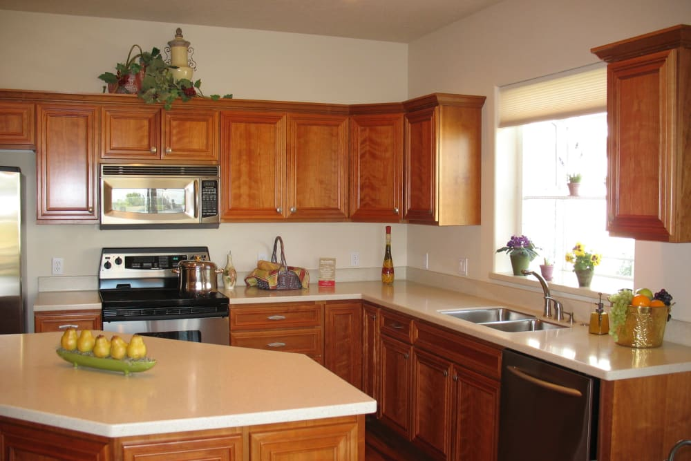 A beautiful kitchen with and island at Touchmark at Meadow Lake Village in Meridian, Idaho