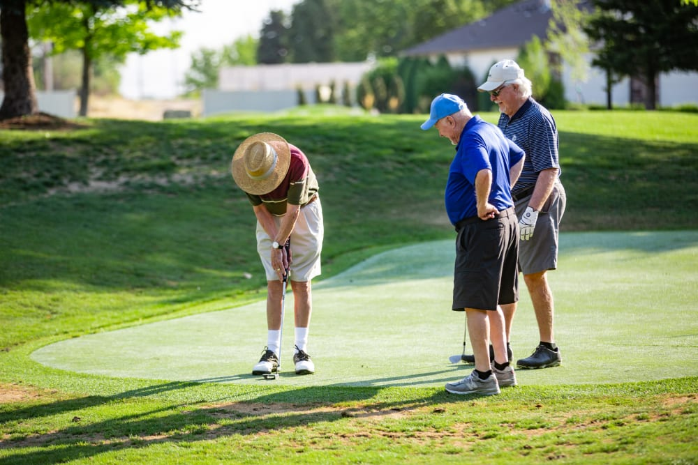 Residents playing a round of golf at Touchmark at Meadow Lake Village in Meridian, Idaho
