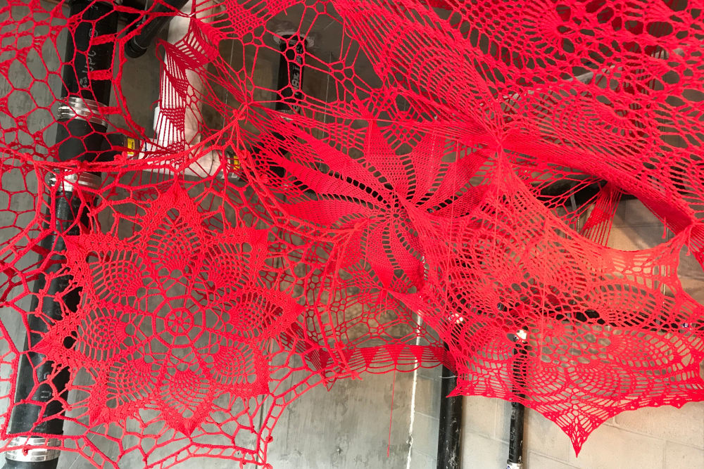 Red lace mask for a past event at Alta Warp + Weft in Charlotte, North Carolina