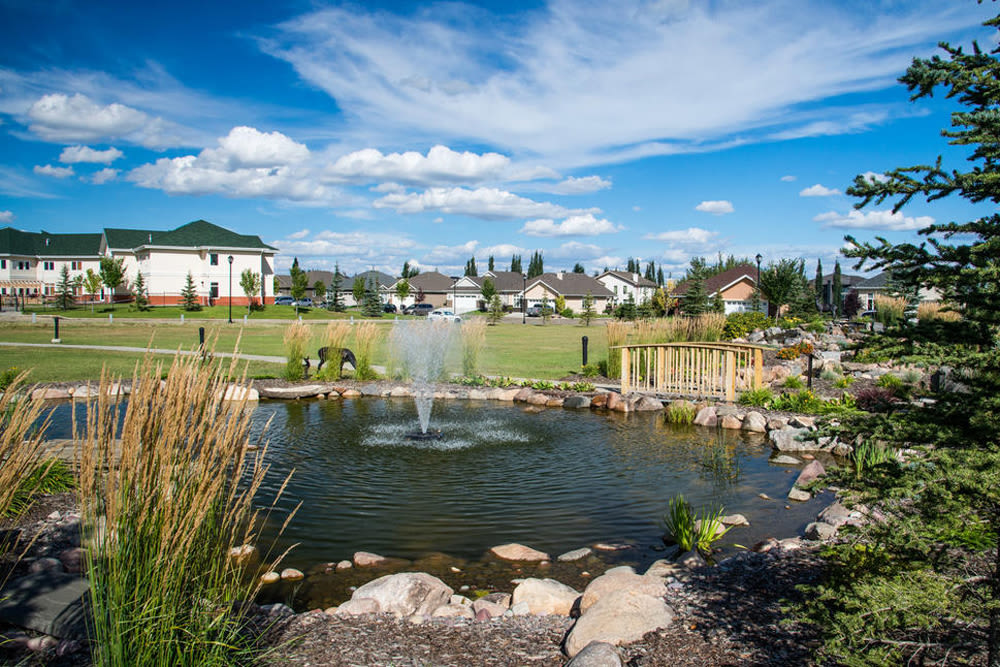 A pond with a fountain at Touchmark at Wedgewood in Edmonton, Alberta